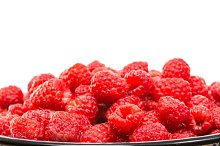 Fresh red raspberries isolated