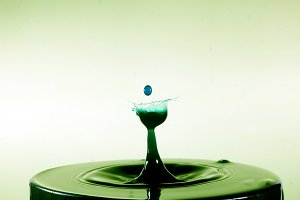 Collision of two drops on water