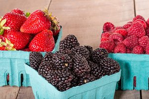 Fresh berries in boxes