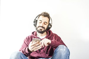 Bearded man listening music