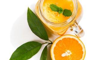Healthy orange smoothie, top view.