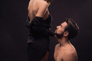 couple passionate kneel stocking