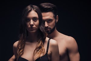 young couple intimate sexy dark