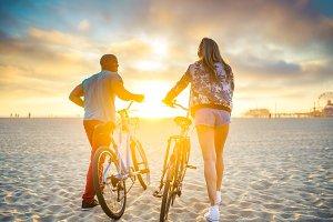 couple walking towards sunset