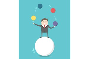 Businessman balancing on ball