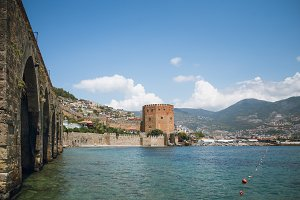 Alanya medieval castle which includes Red Tower Shipyard by sea