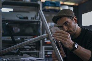 Craftsman works in a bike workshop