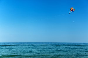 parasailing over the seasea, sky, activity, blue, parachute, peo