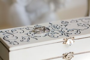 Wedding rings on a white vintage box