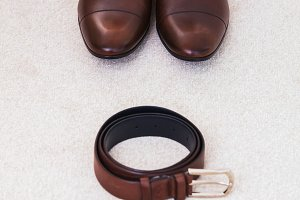Brown leather men's shoes with belt, bow-tie. Set groom accessories.