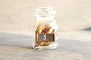 Saving money jar. Golden coins.