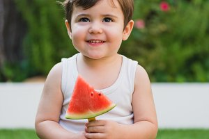 Little kid with a watermelon
