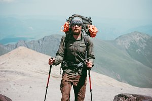 Traveler Man hiking in mountains