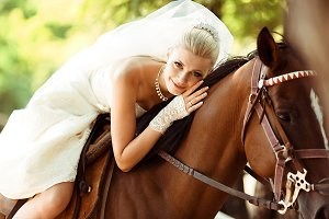 Beautiful bride rides a horse