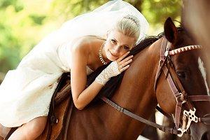 Beautiful bride rides a horse