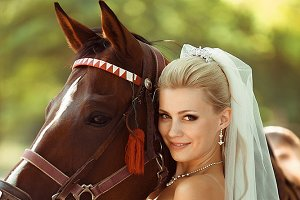 Beautiful bride with the brown horse