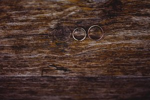 Wedding rings on the wood background