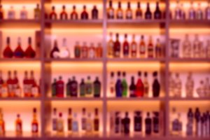 Alcohol bottles in bar, strong blur