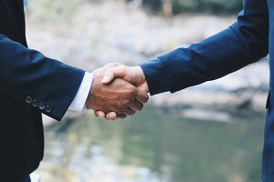 Green business handshake deal
