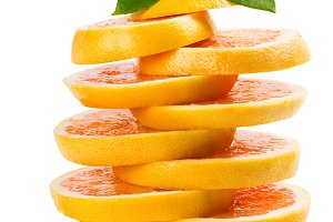 Slices of grapefruit with leaves.