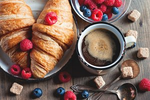 Coffee & croissants with berries