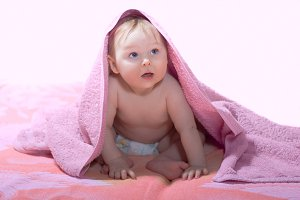 Little baby with pink towel