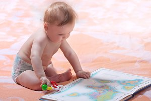 Toddler with maps