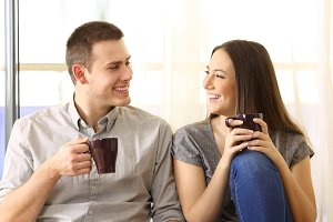 couple talking and drinking coffee
