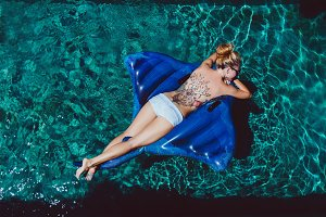 Woman relaxing on swimming pool