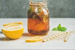 Summer Iced tea with lemon and herbs
