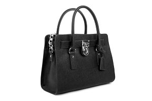Black leather handbag on white