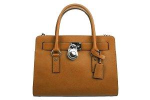 Brown leather handbag on white