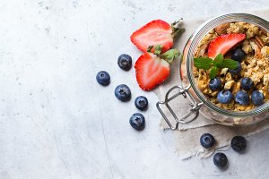 Homemade muesli granola with berries in a jar