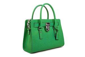 Green leather handbag on white