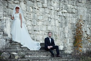 The brides stands near wall