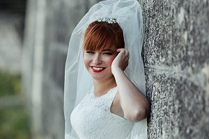 The charming bride near the wall