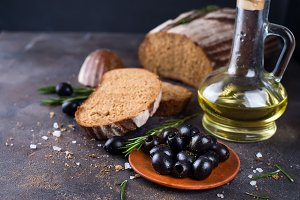 Fresh ciabatta with olive oil and olives