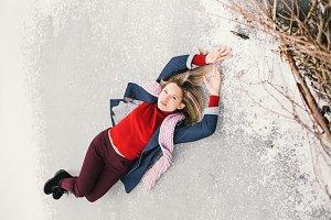 woman lying on the ice