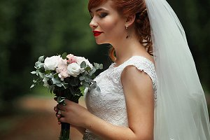 The charming bride in the park