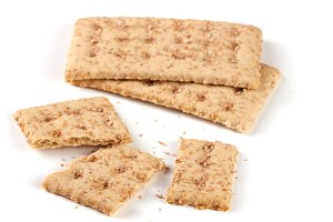 two whole and the broken grain crispbreads isolated on white background
