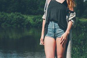 Young Woman walking at river