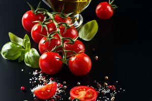 Cherry tomatoes, olive oil and basil