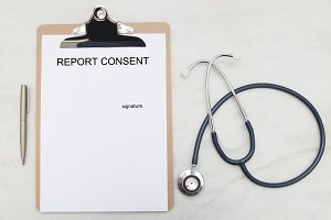 document to sign authorization medical and stethoscope, top view