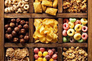 Variety of cold cereals in a wooden box overhead
