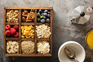 Breakfast foods in a wooden box overhead shot