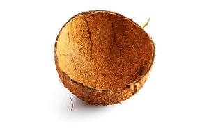 Coconut empty shell, isolated on white.