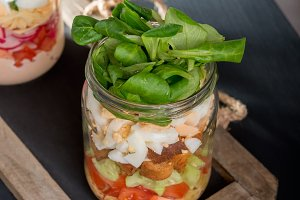 Two glass jars with fresh salad