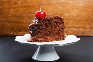 Chocolate cake with juicy cherries