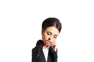 Businesswoman tired because of troubles holding her head