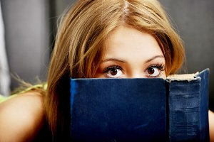 Teenage woman reading a book.